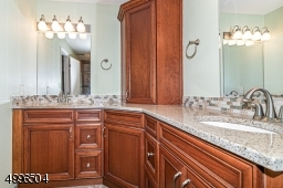 Beautiful custom cabinetry and double sinks.