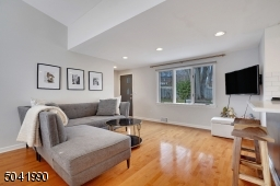 Comfortable Family Room with bay windows.