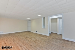 Basement Rec Room, Two Storage Room, Leads to Backyard