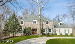 Elegant Center Hall Colonia with 5 bedrooms and 3.5 bathrooms. Circular driveway and double wood front doors.