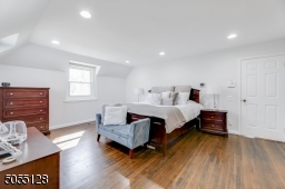 Primary Bedroom Wing features vaulted ceiling, hardwood floors, deep base moldings, recessed lights and 2 exposures of windows.