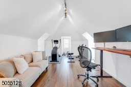 Primary Bedroom Sitting Room / Home Office / features a vaulted ceiling, 3 exposures of windows and double privacy doors.