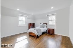 Bedroom 3 features hardwood floors, deep baseboard moldings, 2 exposures of windows, 2 closets and recessed lights