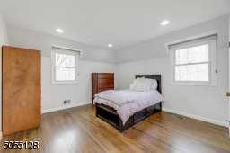 Bedroom 2 features hardwood floors, deep baseboard moldings, 2 exposures of windows, recessed lights and a double closet.