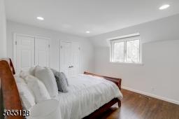 Bedroom 4 features hardwood floors, deep baseboard moldings and recessed lights