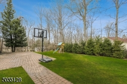 Brick paver patio accessible from Mud Room, Kitchen and Family Room