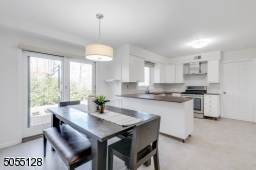 2 floor-to-ceiling pantries, recessed lights, stainless steel KitchenAid appliances, glass sliders to brick paver patio and level rear yard.