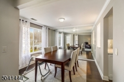 Dining Room features include mirrored wall and crown molding.