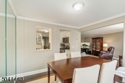 Open pass through to kitchen from the dining room adds to the integrated floor plan.