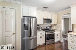 New Kitchen features stainless steel appliances including French door refrigerator and built-in microwave, plus  full-sized pantry.