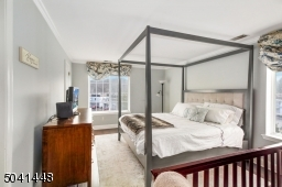 """Sun-lit master bedroom with huge 5'X8' walk-in closet with """"California"""" built-ins."""