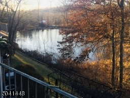 Spectacular, seasonal pond views from the balcony of the turnkey townhome!