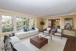 Opens into formal Dining Room and has access out to all season sunroom and private fenced backyard
