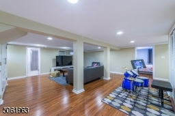 The finished lower level offers plenty of space for a gahering, game or media room. A fifth bedroom and full bath complete the level.