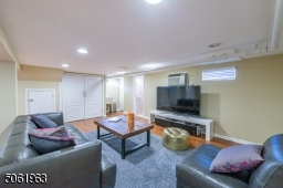 The finished lower level offers plenty of space for a gathering, game or media room. A fifth bedroom and full bath complete the level.