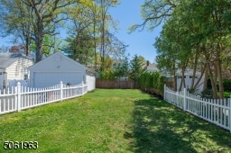 This fenced in lush yard make play (and doggy) dates worry free.