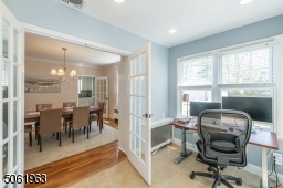 Sitting off of the dining room, this sundrenched office is the perfect space to unleash your creativity.