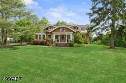 Rare find! Arts and Craft style home situated on an almost acre of parklike property with sweeping front and rear yards.