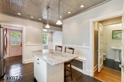 Back entrance leads to the mudroom then kitchen. Powder room located off the hall next to the kitchen.
