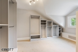 Bedroom adjacent to master currently outfitted as a master walk-in closet.