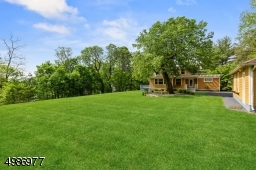 Sweeping lawns grace the rear of the property. Enjoy the outdoors on the private rear patio.