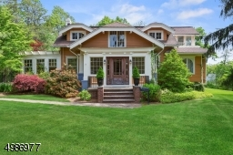 Charming Arts and Craft style home on large one acre parcel in the heart of Westfield.