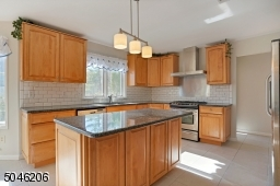 """This kitchen has been nicely remodeled.  the 30"""" cabinets have been updated with 36""""."""