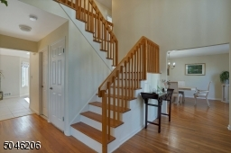 Dramatic double height foyer. Hardwood flooring throughout this fine home.