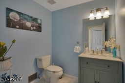 Beautifully remodeled.  At some point there was a shower in this room. The plumbing is still there for you.