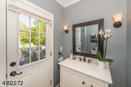 Conveniently located for both interior and exterior (pool/deck) access