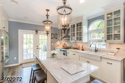Renovated in 2016 to include stainless steel appliances, granite counter tops, built-in microwave oven & wine refrigerator & excellent access to huge Deck through French doors