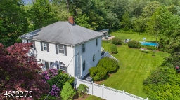 Stunning 1910's colonial set on 1.39 Acres of beautiful, level property with in-ground Pool, Pool House & expansive Deck