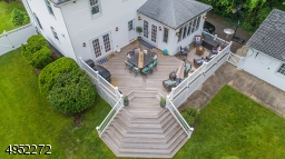 Take your next Prom Photos here on the expansive Deck with sweeping stairs down to the lawn