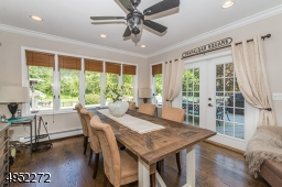 Gorgeous Dining Room with access to Deck and overlooking professionally landscaped property and Pool