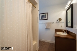 Here you can see the vanity area for this bathroom taken near a window