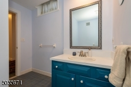 """This is the vanity for the gardent level bathroom and a glimpse of the short hallway to the """"den"""" or sitting area."""