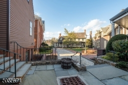 """Here is a glimpse of the special community this home is a part of.  Cobblestone pathways, flagstone sidewalks lead to beautiful """"square"""" commons surrounded by historic replica village homes.  Truly a unique community."""