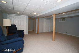 recreation room has new carpet, recessed lighting and plenty of closet space plus a powder room and laundry room.