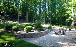 Another view which showcases the terrace, landscape and patio. Such a private oasis to sit back and enjoy natures bounty!