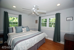 features recessed lighting, a ceiling fan light, chair rail and maple flooring.
