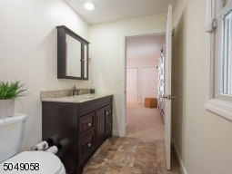 The handicap accessible in-law suite has two half baths, connected by a walk-in shower.