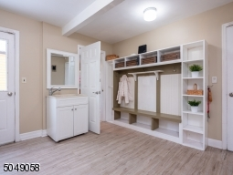 The mudroom provides access to the garage, secondary access to the backyard, main home kitchen, and in-law suite.