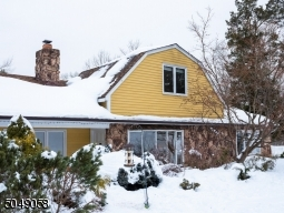 The beautiful landscaping is currently hidden by the continuous snow of 2021. Additional homeowner pictures available upon req. showing landscaping