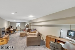 This large family room can be divided for different activities, an office, TV watching, exercise.