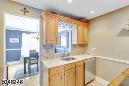 The kitchen has new stainless steel appliances and overlooks the dining room.