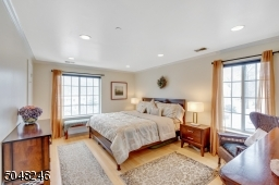 A bright and sunny room, this owner's bedroom has a large walk in closet and bamboo wood floors.