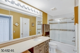 Bathroom with large vanity and tub/shower.
