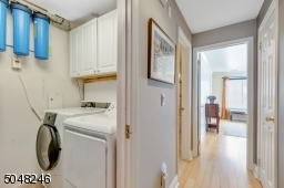 The laundry room and utility closet are conveniently located in the main hallway.