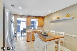 Lovely kitchen with a center island, perfect for morning coffee and a quick bite to eat.
