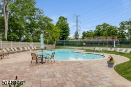 Relax at the pool all summer long, just steps away from the front door.